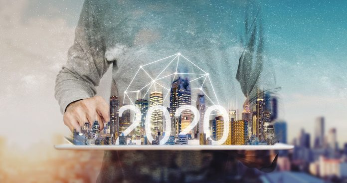 Man holding city skyline on tray with 2020
