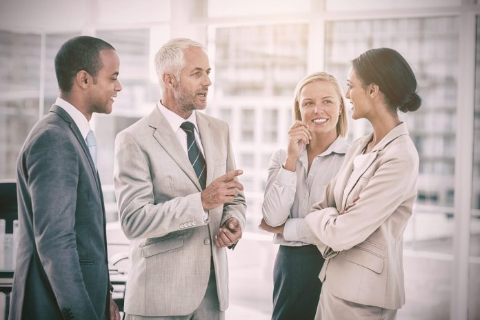 group of professionals negotiating in office