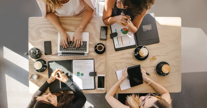women business meeting around coffee shop table