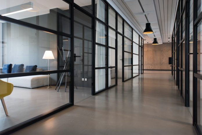 empty hallway showing empty office spaces